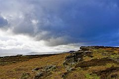 Clouds gather over Bamford Edge, in Derbyshire. Taken to capture the rich colourations and varied terrain, surrounding Bamford, in the Peak District, Derbyshire stock photo