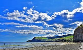 Clouds gather over Boggle Hole, along the Cleveland Way in Yorkshire. stock photos