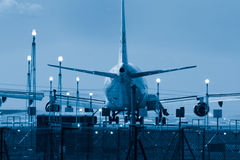 Takeoff. Airliner on runway. Ready for takeoff. A blue toned image Royalty Free Stock Photo