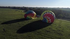 Takeoff air balloon at sunset , air balloons start fly from grass field at summer sunset, air balloons on field with