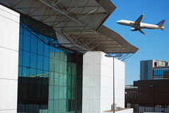The takeoff of an airplane. Takeoff of an airplane and architecture of the airport of Fiumicino royalty free stock photography