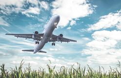 Takeoff from an airplane on a field. With cloudy backgrund Stock Image