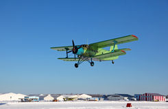 Takeoff biplane an-2. Biplane makes a landing on Runway winterTakeoff biplane an-2 Stock Image