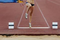 Takeoff board and leg athletes women Royalty Free Stock Photos
