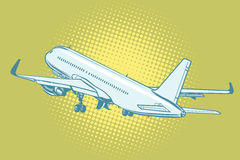 The takeoff of a passenger plane. Pop art retro vector illustration Stock Images