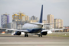Takeoff runway of Kyiv International Airport, Zhuliany. Plane of YanAir company is prepared for takeoff. Royalty Free Stock Photo
