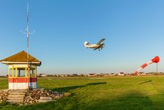 The takeoff strip of the aircraft. A private plane takes off on the runway. The takeoff strip of the aircraft Royalty Free Stock Images