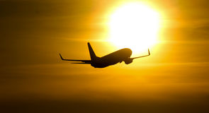 Takeoff in to the sun. Boeing takeoff morning Stock Images