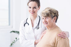 She always takes a good care of her patients Stock Photo
