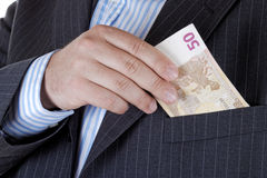 takes out money from your pocket. Stock Photography