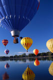 Takes Your Breath Away. Close up of Hot Air Balloons, drifting over lake with reflection stock images