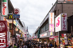 Takeshita Street in the Harajuku district of Tokyo, Japan. Tokyo, Japan - December 6, 2015: Crowds of people walk through Takeshita Street in the Harajuku Royalty Free Stock Photos