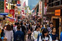 Takeshita street in Harajuku, Tokyo. Tokyo, Japan - May 7, 2017: Unidentified people visit Takeshita street in Harajuku, famous of unique Japanese cosplay street Royalty Free Stock Images