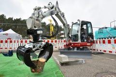 Takeuchi excavator in action stock image
