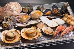 Takeyama of grilled seafood with shells clams shrimp mussels Royalty Free Stock Photo