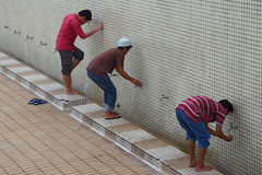 Taking Ablution. Three man taking ablution at Malaysia National Mosque Royalty Free Stock Photography