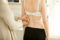 Taking accurate waist measurements Royalty Free Stock Image