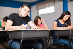 Taking an admission test. Many teens solving an admission test for high school royalty free stock image