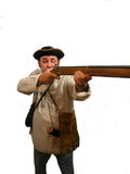 Taking Aim. A pioneer with his rifle up and taking aim,over white Stock Photography