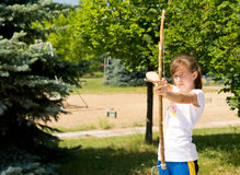 Taking aim. Little girl is practicing the sport with bow and arrow Stock Photography