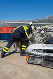 Taking apart. Firefighters taking apart car during drill of rescuing Stock Photos