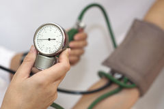 Taking an arterial blood pressure. By medical equipment tonometer royalty free stock images