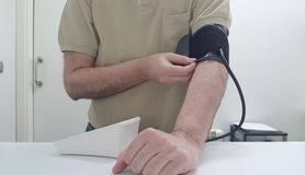 Taking of the arterial tension. With a digital tensiometer stock photos