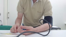 Taking of the arterial tension. With a digital tensiometer royalty free stock photography