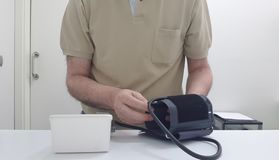 Taking of the arterial tension. With a digital tensiometer stock photography