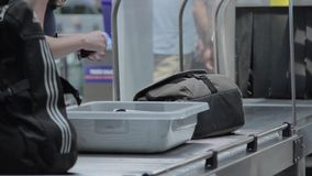 Taking Bags on the X-Ray machine. Close up stock footage