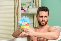 Taking bath with soap suds. Beauty routine. Relax and fun concept. Daily bath helps beat depression. Handsome muscular royalty free stock photography