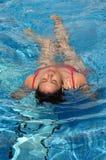 Taking bath on a swimming pool. Beautiful women taking bath on a swimming pool in vacation Royalty Free Stock Photo