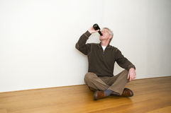 Taking A Beer In An Empty Room Royalty Free Stock Images