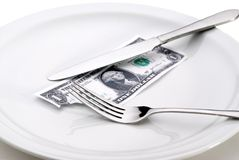 Taking a bite out of the economy. Money with a bite taken out of it. Representing taking a bite out of the economy or the increasing cost of food stock photography