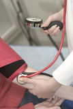 TAKING BLOOD PRESSURE Stock Images