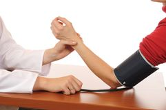 Taking the blood pressure Royalty Free Stock Photography