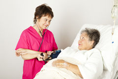 Taking Blood Pressure in Hospital Stock Photography