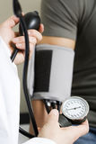 Taking blood pressure reading Royalty Free Stock Photo