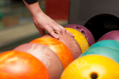 Taking bowling ball Stock Images