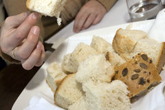 Taking bread. Man with nice nails is taking bread Stock Image