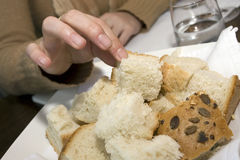 Taking bread. Man with nice nails is taking bread Stock Photography
