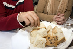 Taking bread. Man with nice nails is taking bread Royalty Free Stock Photos