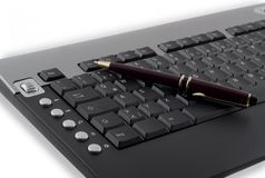 Taking a break. Black computer keyboard with pen Stock Photography