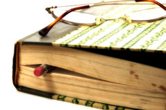 Taking a Break. Photo of a Closed Book with a Pencil and Eyeglasses With Slight Blur Effect Stock Photos