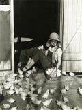 Taking a break from barnyard chores stock image