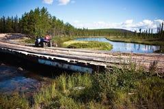 Taking a break on a creek crossing Stock Photos