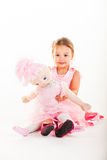 Taking a break with her doll Anabelle. royalty free stock photo