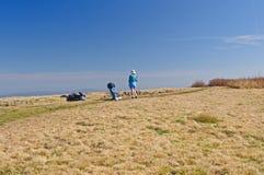 Taking a break on a mountain ridge. Backpacker taking a break on Gregory Bald in the Smoky Mountains Stock Image
