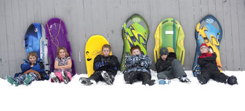 Taking a break from sledding. Stock Image