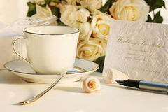 Taking a break for tea and writing invitation Stock Photo